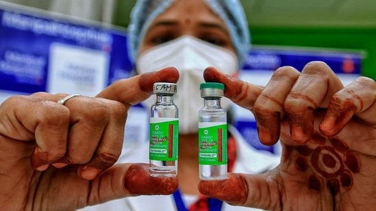 A medic shows Covishield vaccine vials, after the virtual launch of the Covid-19 vaccination drive by Prime Minister Narendra Modi, at Manipal Hospital in Jaipur, Saturday, Jan. 16, 2021.