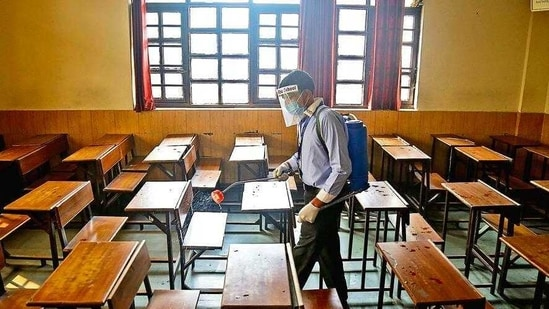 A classroom at Mount Abu School in Rohini being sanitised, a day before schools in Delhi resume in-person sessions for students of classes 10 and 12.( anchit Khanna/HT PHOTO)