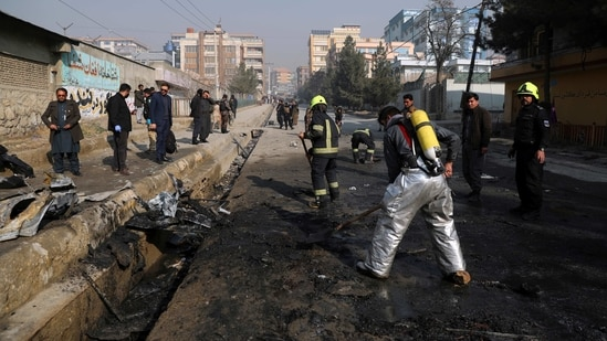 Afghan firefighters work at the site of a bombingh attack in Kabul, Afghanistan, Sunday, Jan. 10, 2021. A roadside bomb exploded in Afghanistan's capital Sunday, killing at least a few people in a vehicle, the latest attack to take place even as government negotiators are in Qatar to resume peace talks with the Taliban. (AP Photo/Rahmat Gul)(AP)