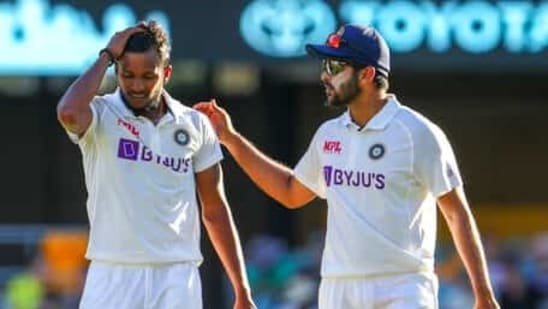 India's Thangarasu Natarajan, left, and India's Shardul Thakur talk during play on the first day of the fourth cricket test between India and Australia at the Gabba, Brisbane.(AP)