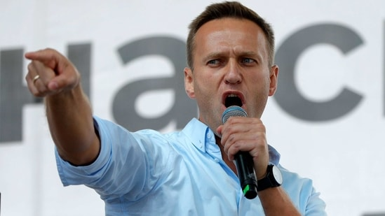 Russian opposition activist Alexei Navalny gestures while speaking to a crowd during a political protest in Moscow, Russia. (AP)