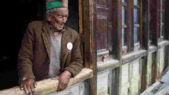Shyam Saran Negi, 102, independent India's first voter who has participated in all elections since 1951, looks out from his house ahead of the final phase. The election was also being seen as a referendum on Prime Minister Narendra Modi, after losses to regional parties in key state elections indicated waning support and a possibility of serious completion in this election. (Cheena Kapoor / REUTERS)