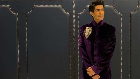 Manish Malhotra redefines fashion goals for men in purple sherwani with emblem(Instagram/manishmalhotra05)
