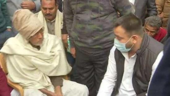 RJD leader Tejashwi Yadav with family of murdered IndiGo Patna station's manager. (ANI Photo )