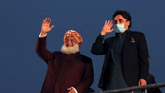 Pakistani politician Maulana Fazlur Rehman and Bilawal Bhutto Zardari, chairman of the Pakistan Peoples Party (PPP), wave to the supporters during an anti-government protest rally organized by the Pakistan Democratic Movement (PDM) in Lahore, Pakistan.(Reuters)
