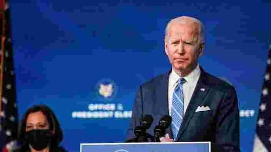 US President-elect Joe Biden delivers remarks as Vice President-elect Kamala Harris looks on during a televised speech on the current economic and health crises,(REUTERS)