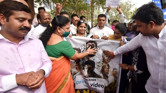 Bharatiya Janata Party leader Ram Kadam looks on as his supporters blacken the faces of actors on the poster of Amazon Prime Video's web series Tandav during a protest in Mumbai on Monday.(ANI)