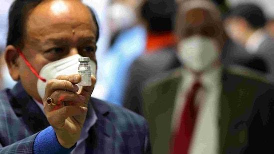 Union health minister Harsh Vardhan displays a vial of Bharat Biotech Ltd. Covaxin at the All India Institute of Medical Sciences in New Delhi.(Bloomberg Photo )