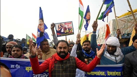 Supporters of farmers take part in a flag march along a blocked highway as farmers continue to protest against the central government's recent agricultural reforms at the Delhi-Uttar Pradesh state border in Ghazipur on January 17. (AFP)