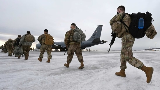 Airmen and soldiers from the Alaska National Guard prepare to depart from Joint Base Elmendorf-Richardson to assist with the inauguration of President-elect Joe Biden in Washington.(AP)