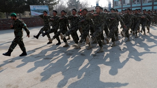 Newly graduated Afghan National Army march during their graduation ceremony after a three-month training program at the Afghan Military Academy in Kabul, Afghanistan, Monday, Jan. 18, 2021. (AP Photo/Rahmat Gul)(AP)