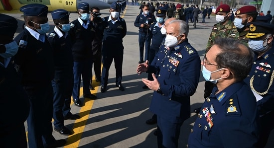 Pakistani Air Chief Marshal Mujahid Anwar Khan speaks to Nigerian security personnel in this file picture. (AFP)