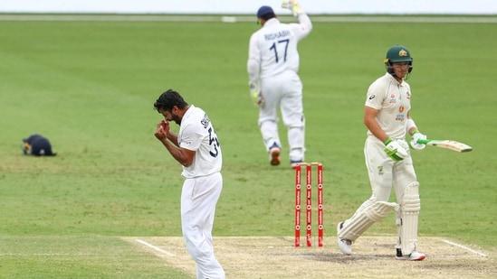 Brisbane : India's Shardul Thakur, left, celebrates the dismissal of Australia's Tim Paine, right, during play on day four of the fourth cricket test between India and Australia at the Gabba, Brisbane, Australia, Monday, Jan. 18, 2021. AP/PTI(AP01_18_2021_000018B)(AP)