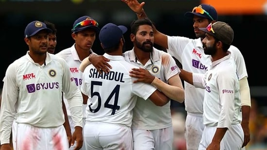 Mohammed Siraj is congratulated by his teammates after getting his fifth wicket. (Getty Images)