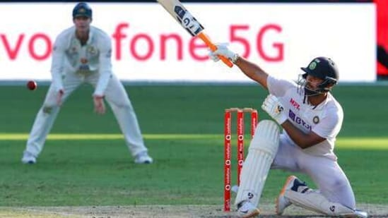 India's Rishabh Pant hits the ball to the boundary on the final day of the fourth cricket test against Australia at the Gabba, Brisbane, Australia, Tuesday, Jan. 19, 2021.India won the four test series 2-1. (AP Photo/Tertius Pickard)(AP)