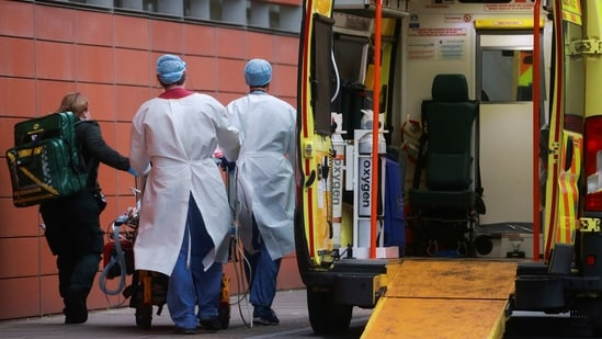 Health care workers transport a patient at the Royal London Hospital, as the spread of the coronavirus disease (COVID-19) continues, in London, Britain(REUTERS)