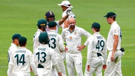 Australia's Nathan Lyon, centre, reacts as his video review is rejected during play on the final day of the fourth cricket test between India and Australia at the Gabba, Brisbane, Australia, Tuesday, Jan. 19, 2021. (AP Photo/Tertius Pickard)(AP)