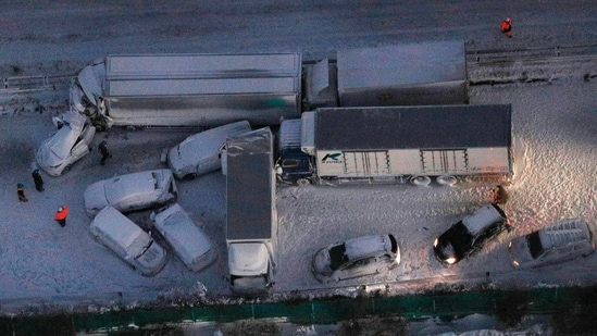Damaged cars covered with snow after multiple accidents on the snowy Tohoku Expressway in Osaki city, northern Japan.(AP)