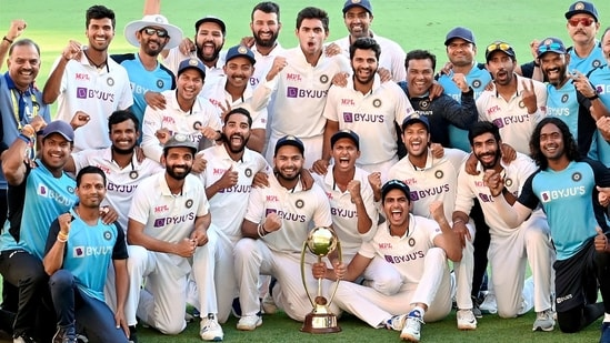 Indian players pose with the winning trophy after defeating Australia by three wickets on the final day of the fourth cricket Test match at the Gabba, Brisbane(PTI)