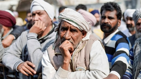 Farmers during their ongoing protest against the new farm laws at Singhu Border, in New Delhi.