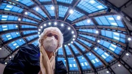 After receiving her vaccination against the novel coronavirus, 90-year-old Odores H. sits under the domed roof of the vaccination centre in the Festhalle in Frankfurt, Germany,(AP)