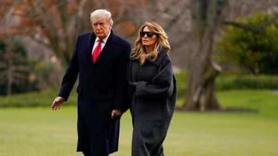 President Donald Trump and first lady Melania Trump on the South Lawn of the White House on Dec. 31, 2020, in Washington(AP File Photo )