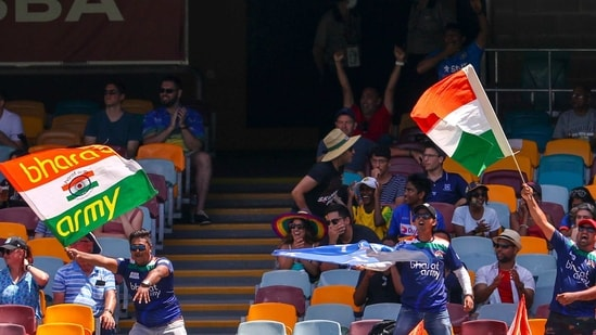 Indian supporters wave flags as they cheer their team during play on the final day of the fourth cricket test between India and Australia at the Gabba, Brisbane, Australia, Tuesday, Jan. 19, 2021. (AP Photo/Tertius Pickard)(AP)