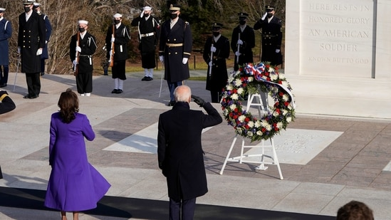 President Joe Biden and Vice President Kamala Harris salute at the Tomb of the Unknown Soldier at the Arlington National Cemetery.