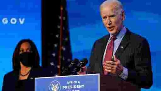 Vice President-elect Kamala Harris listens as President-elect Joe Biden speaks during an event at The Queen theater in Wilmington.(AP File Photo )