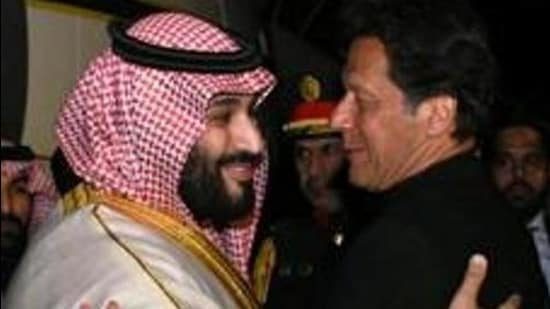 Pakistani Prime Minister Imran Khan (R) greets Saudi Arabia's Crown Prince Mohammed bin Salman in Rawalpindi, Pakistan in 2019. (REUTERS)