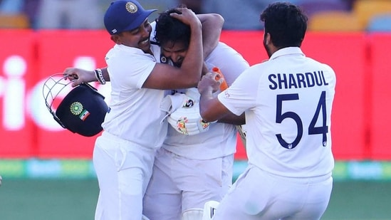 India's Rishabh Pant, centre, is congratulated by teammates.(AP)