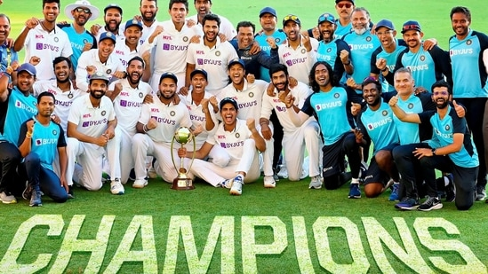 Indian players pose with the winning trophy after defeating Australia by three wickets on the final day of the fourth cricket test match at the Gabba, Brisbane, Australia, (PTI)