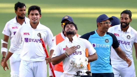 Indian players celebrate after defeating Australia by three wickets on the final day of the fourth cricket test match at the Gabba, Brisbane, Australia, Tuesday, Jan. 19, 2021. India won the four test series 2-1. (PTI)