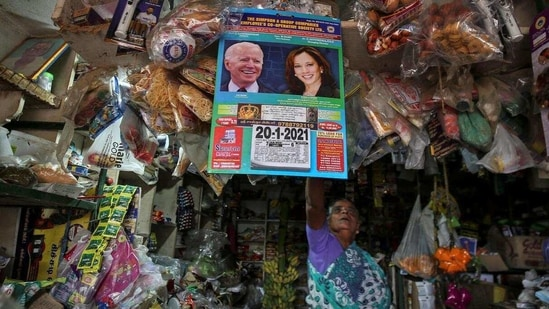 People even offered prayers at the village temple for Kamala Harris. In picture - A shop in the village hanging a calendar with the image of Joe Biden and Kamala Harris.(Reuters)