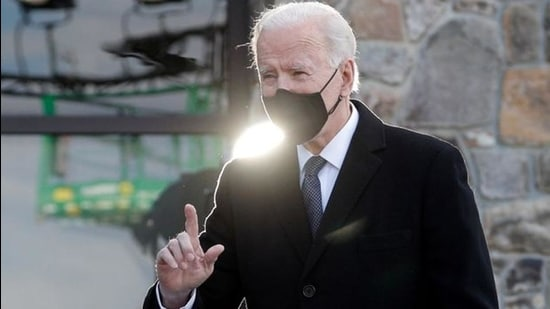 """US President-elect Joe Biden arrives to speak during an event at Major Joseph R. """"Beau"""" Biden III National Guard/Reserve Center at New Castle County Airport in New Castle, Delaware, US January 19, 2021. (REUTERS)"""