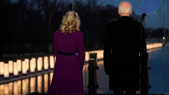 President-elect Joe Biden and his wife Jill Biden look out at lights during a COVID-19 memorial, with lights placed around the Lincoln Memorial Reflecting Pool, Tuesday,(AP Photo )