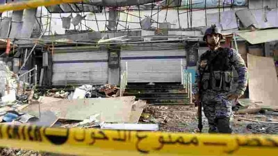 An Iraqi policeman stands guard at the site of a car bomb attack in Baghdad.(Representative Image/Reuters File Photo)