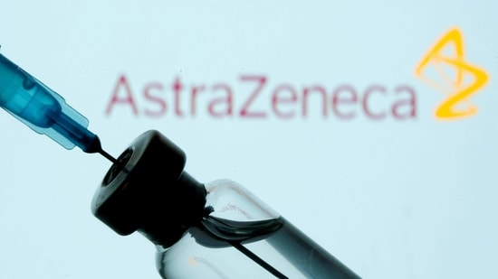 A vial and syringe are seen in front of a displayed AstraZeneca logo.(Reuters)