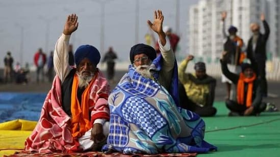 Farmers take part in a protest against the three farm laws on the outskirts of Delhi.(Reuters Photo)