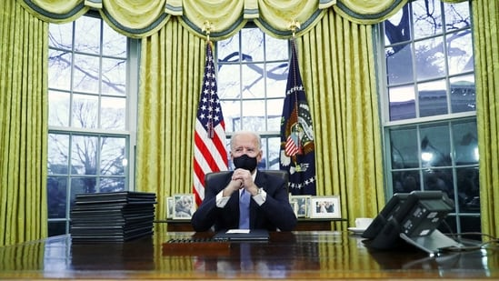 U.S. President Joe Biden signs executive orders in the Oval Office of the White House in Washington, after his inauguration as the 46th President of the United States, U.S., January 20, 2021. REUTERS/Tom Brenner(REUTERS)
