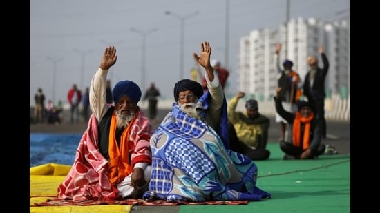 Farmers take part in a protest against the newly passed farm laws on the outskirts of Delhi, December 17, 2020 (REUTERS)
