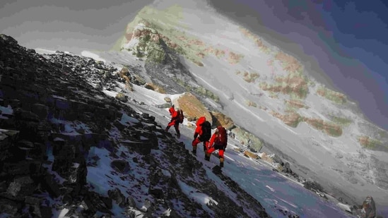 Members of a Chinese surveying team head for the summit of Mount Everest. (AP File Photo )