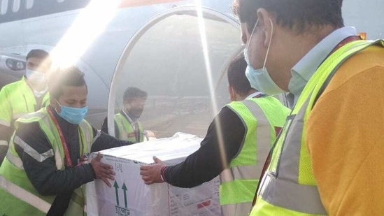 Covid-19 vaccines being unloaded from a flight at the Dehradun airport. (HT PHOTO).