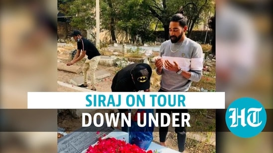 Siraj visits father's grave