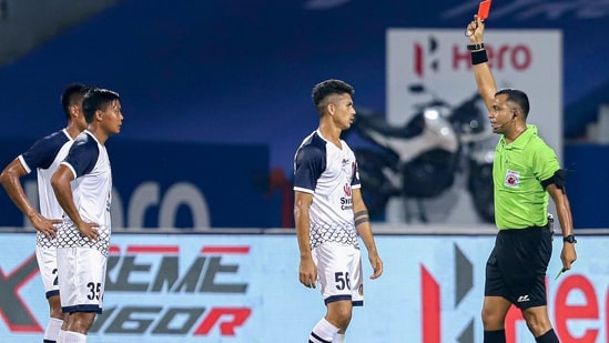 Referee gives a red card to Ajay Chhetri of SC East Bengal during the Indian Super League match between Chennaiyin FC and SC East Bengal at GMC Stadium Bambolim in Goa(PTI)