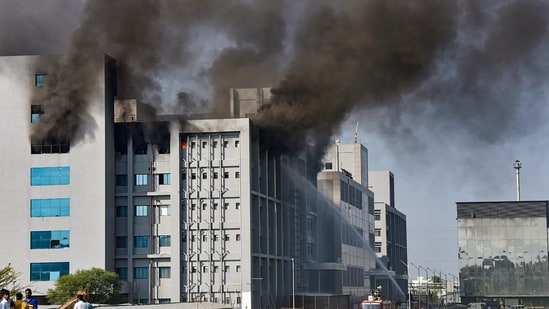 Smoke billows out after a massive fire broke out at the Serum Institute of India, in Pune, Thursday.(PTI)