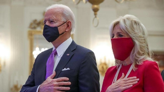 U.S. President Joe Biden and first lady Jill Biden stand for the national anthem sung by Patti LaBelle as they participate remotely in a virtual Presidential Inaugural Prayer Service from the State Dining Room at the White House in Washington, U.S., January 21, 2021.(Reuters)