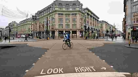 A cyclist rides across an empty Oxford Street in London as Britain heads into a national lockdown on January 5. British Prime Minister Boris Johnson on January 4 ordered England into a new national lockdown to contain a surge in Covid-19 cases that was threatening the British healthcare system before a vaccine programme reached a critical mass. (Justin Tallis / AFP)
