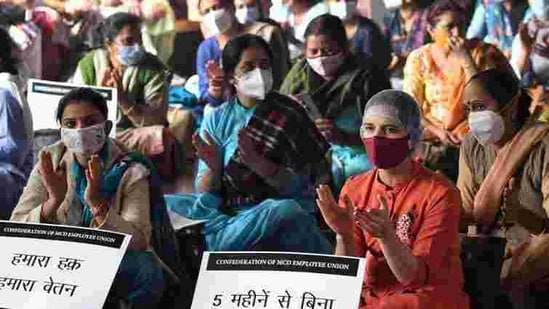MCD doctors and other staff during a protest at Civic center, in New Delhi .(ANI file photo)