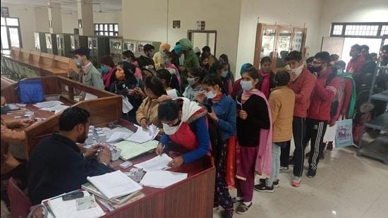 Students queue up at the library of Government Rajindra College, Bathinda, on Thursday to collect admit cards for exams. (Sanjeev Kumar/HT)